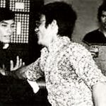 Carter Wong and Bruce Lee exchanging martial arts tips